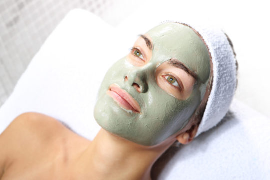 Herbal facial mask on a young woman